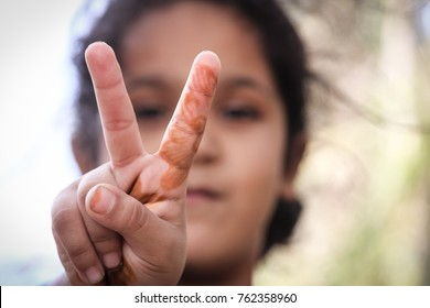 LAAYOUNE, WESTERN SAHARA NOVEMBER 9 2016: a saharaui young girl making peace sign for western sahara and africa in front of UN MINURSo headquarter, africa