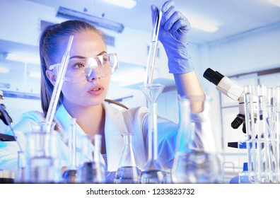 Lab concept. Woman scientist conducting experiment. Laboratory interior and equipment.