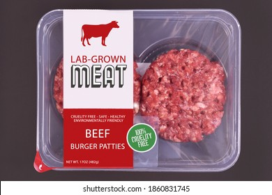 Lab grown cultured meat concept for artificial in vitro cell culture meat production with packed raw burger patties with made up label