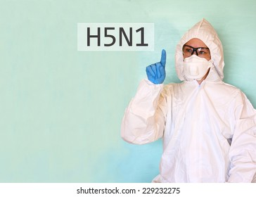 Lab scientist in safety suit drawing word H5N1