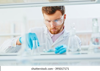 Lab technician doing experiment in lab