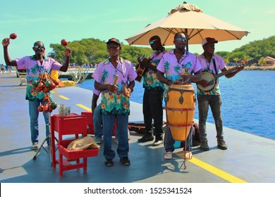 Labadee, Haiti - August 21st 2019: Local musicians play traditional music to greet the passengers arriving off of a Royal Caribbean cruise ship to it's privately owned resort of Labadee, Haiti.