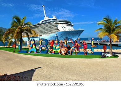 Labadee, Haiti - August 21st 2019: Tourists pose for photos in front of the Royal Caribbean Anthem Of The Seas cruise ship, on the Royal Caribbean privately owned resort of Labadee, Haiti.