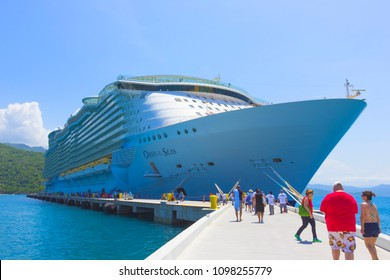 LABADEE, HAITI - MAY 01, 2018: The people going to Royal Caribbean cruise ship Oasis of the Seas docked at the private port of Labadee in the Caribbean Island of Haiti