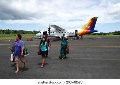 LABASA, FIJI - NOVEMBER 19: Unidentified people get out of the Fiji Airways airplain on November 19, 2013 in Labasa, Vanua Levu island, Fiji. Fiji Airways is the flag carrier airline of Fiji.