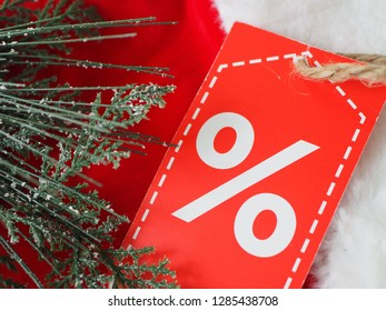 Label with a discount on the cap of Saint Nicholas, an opportunity for Christmas discounts