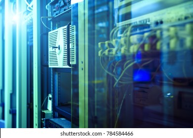 label of fiber optic cable and high speed network router switch in a technology data center room . blur background