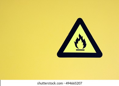 label flammable chemical. Yellow background