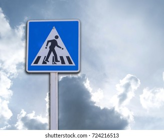 label People cross the road On the sky background