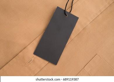 Label price tag mockup on beige shirt.