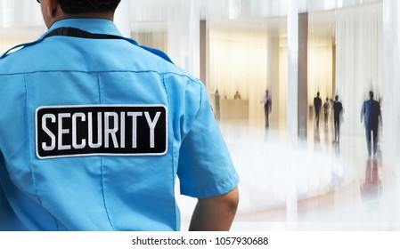 "label ""security"" on guard uniform in the business office"