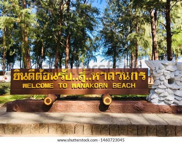 "Label ""Welcome to Wanakorn beach"" in Thai language post on Wanakorn beach national park, Thailand"