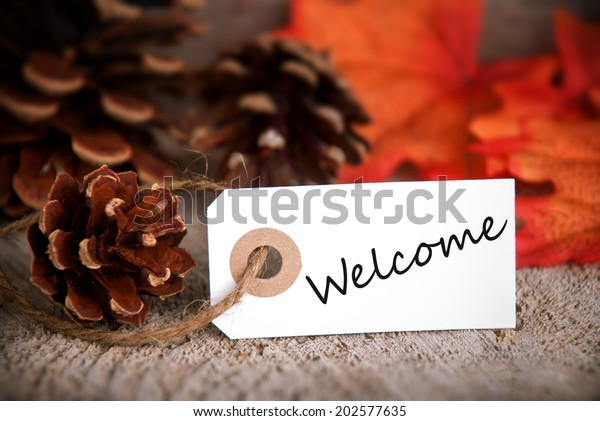 Label with Welcome on it as Fall Background
