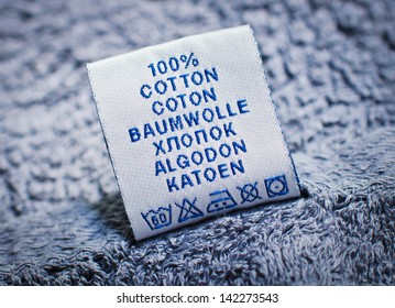 "A label with the word ""cotton"" in six languages"