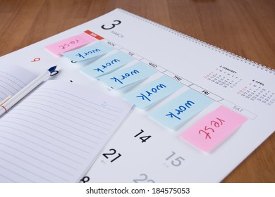 Label with work and rest on a calendar