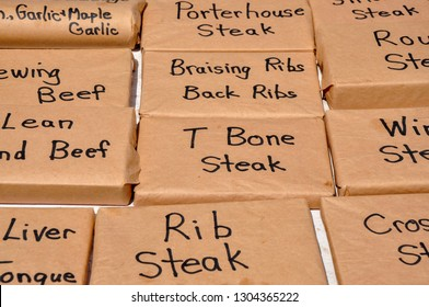 Labeled butcher's paper wrapped blocks provide a product display at a local farmer's market.