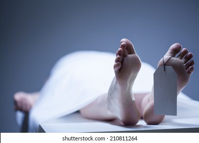 Labeled remains of person lying in mortuary