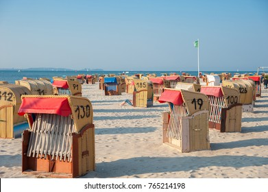 LABOE, SCHLESWIG-HOLSTEIN, GERMANY - SEPTEMBER 18, 2014: Beach with hooded beach chairs in Laboe at the Baltic Sea