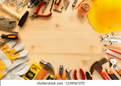 Labor day background concept.Variety of tools on wooden background with copy space for text.Top view of hand tools on a wooden table for labor day promotion