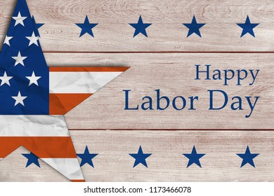 Labor Day background, with text, blue stars  and patriotic star on wooden background.