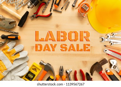 Labor day sale background concept.Variety of tools on wooden background with copy space for text.Top view of hand tools on a wooden table for labor day sale promotion