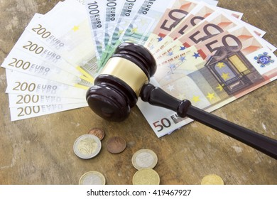 Labor law concept, gavel and money on wooden table