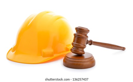 Labor law concept, wooden judge gavel and yellow helmet isolated on white background