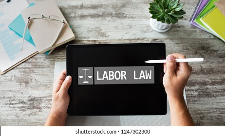 Labor law icon and text on device screen.