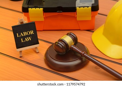 Labor law theme with wooden gavel on table, legislation concept