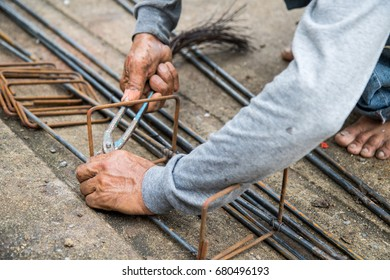 Labor is tying steel for construction site