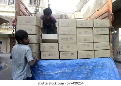 Labor unloading biscuits package at a distributor godown or warehouse December 09, 2016 in Calcutta, India.