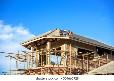 labor working in construction site for roof