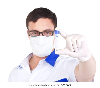 Laboratory assistant in breather shows a test tube