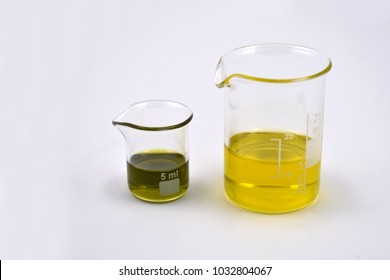 Laboratory beakers with fluid stock images. Glass Measuring Beaker. Laboratory beaker on a white background. Beaker with oil. Glassware with chemical liquid