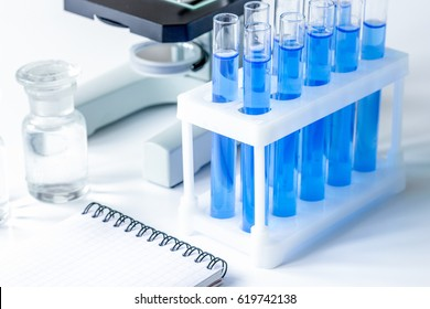 Laboratory, chemistry and science concept on white background