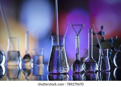 Laboratory concept. Science experiment. Laboratory glassware, microscope.