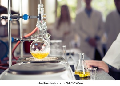 Laboratory equipment for distillation.Separating the component substances from liquid mixture with evaporation and condensation. Industrial chemistry. Pharmaceutical research. Erlemeyer flask, apparatus