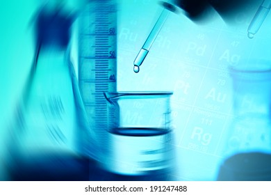 Laboratory glassware and arm with pipette