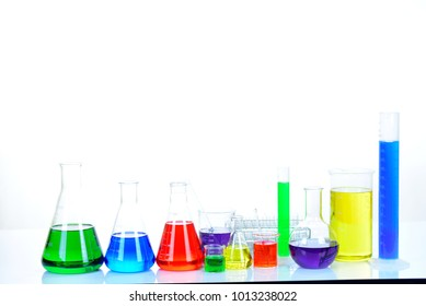 Laboratory glassware with colorful chemical reagent in research laboratory