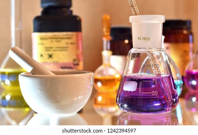 Laboratory glassware with colorful solution and chemicals in the