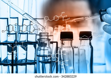 Laboratory glassware containing chemical liquid, science research,Double exposure of scientist and test tubes, laboratory concept.with chemical equations