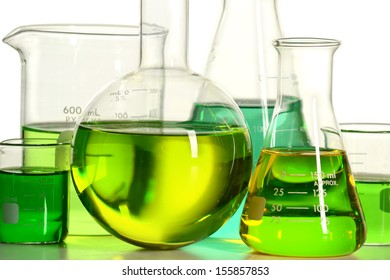 Laboratory glassware with green liquid