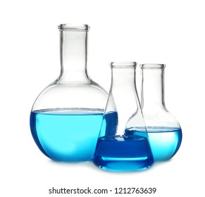 Laboratory glassware with liquid on table against white background. Chemical analysis