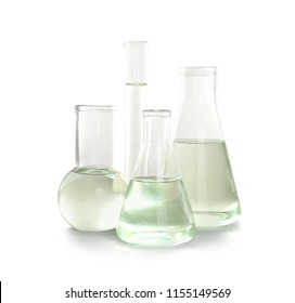 Laboratory glassware with liquid on white background. Chemical analysis