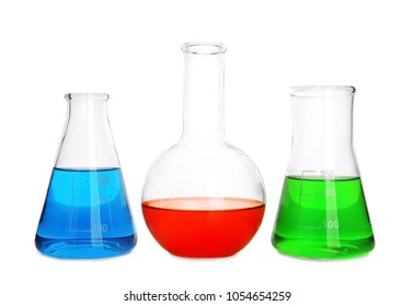 Laboratory glassware with liquids on white background