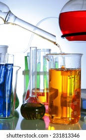 Laboratory glassware on light background