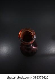 Laboratory glassware -reagent bottle on black background ,science background.