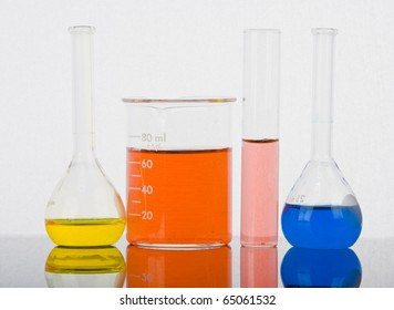 Laboratory glassware with reflections on white background