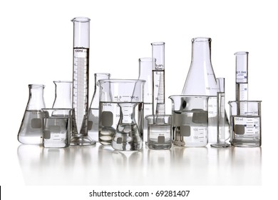 Laboratory glassware with transparent liquid isolated over white background - With clipping path
