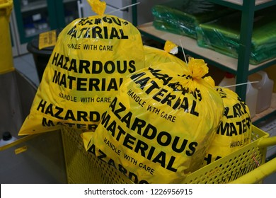 Laboratory hazardous material waste waiting for disposal.